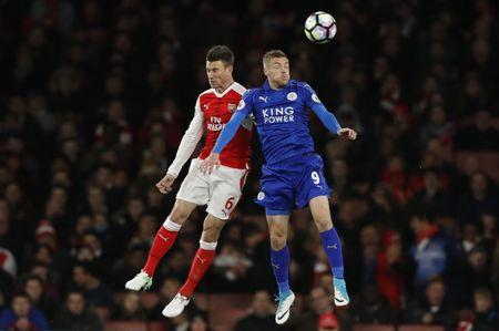 Arsenal's Laurent Koscielny in action with Leicester City's Jamie Vardy