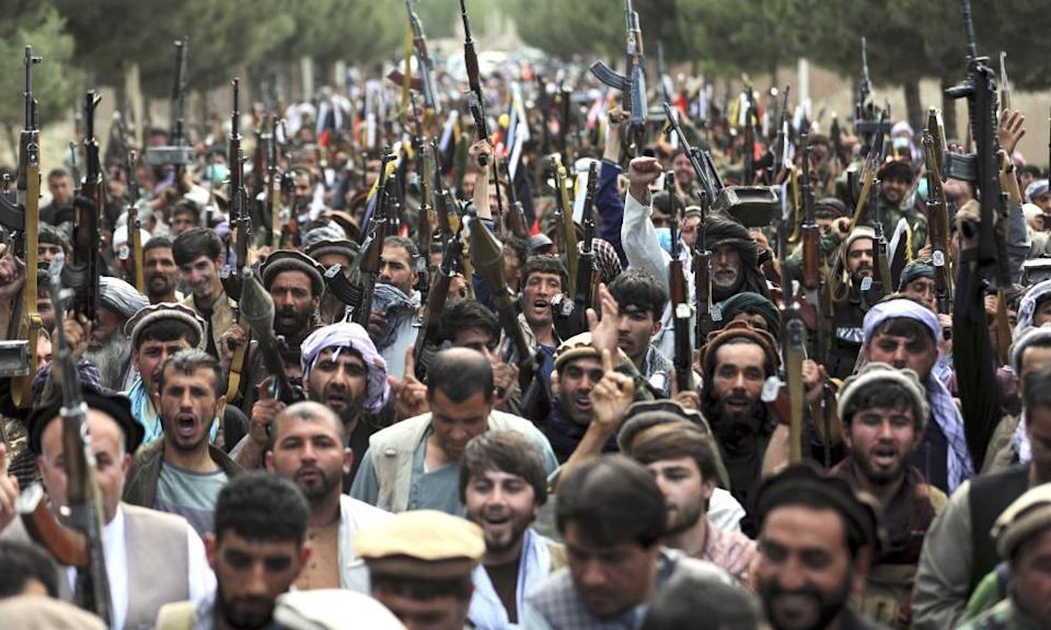 Afghan militiamen in Kabul join Afghan security forces during a gathering to mobilise local militias to try to stem Taliban military gains.
