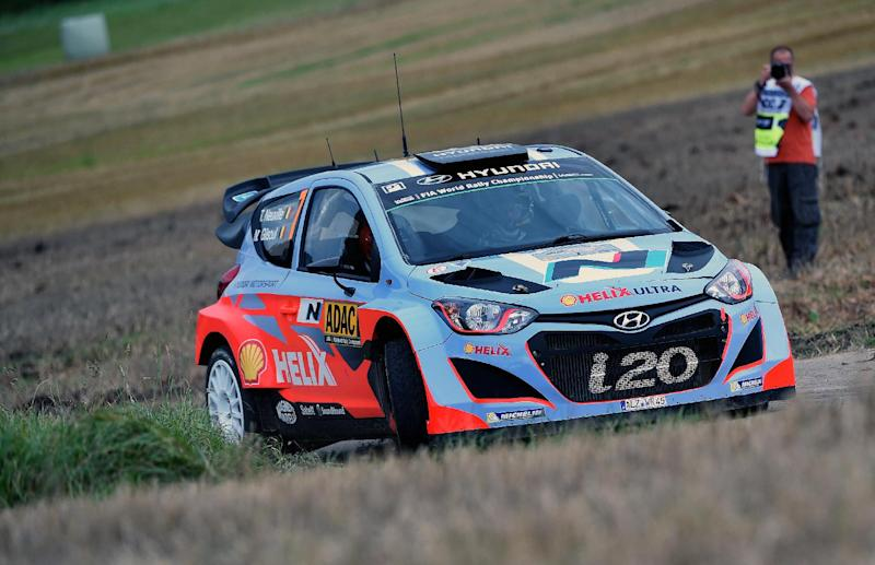 Belgium driver Thierry Neuville and his compatriot co-driver Nicolas Gilsoul steer their Hyundai i20 WRC as they compete during the FIA World Rally Championship of Germany in Trier, western Germany on August 22, 2014 (AFP Photo/Patrik Stollarz)