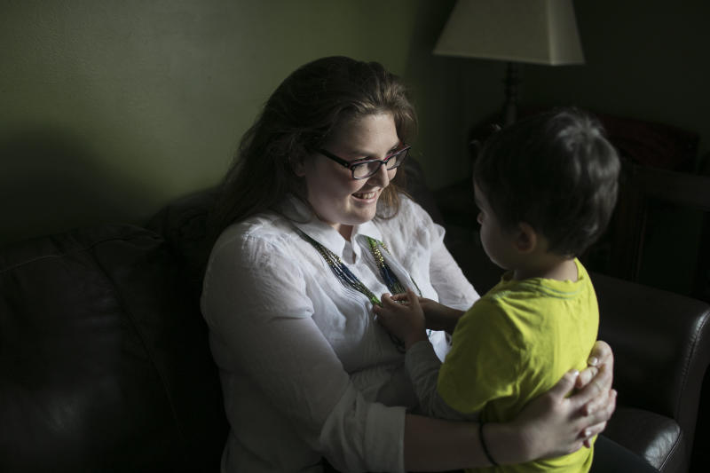 Tiffany Ann Stacy holds her son at home in Cuyahoga Falls, Ohio. Stacy, born in the U.S., lives with her husband from Nepal, their children and his parents.