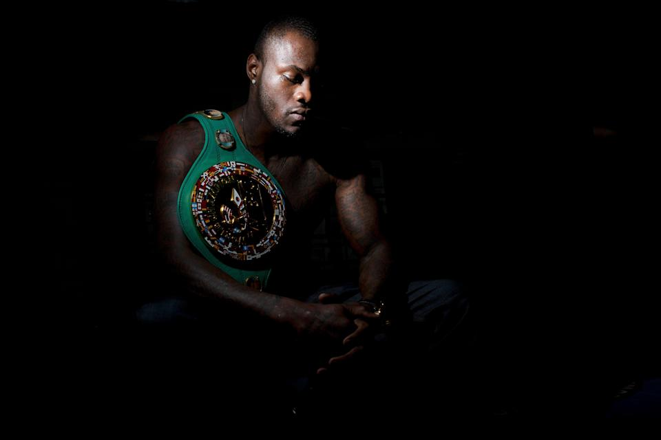 File - In this Monday, Feb. 23, 2015 file photo, WBC heavyweight boxing champion Deontay Wilder poses for a portrait at Skyy Boxing Gym in Northport, Ala. Wilder is scheduled to fight boxer Tyson Fury on Saturday, Dec. 1, 2018. (AP Photo/Brynn Anderson, File)