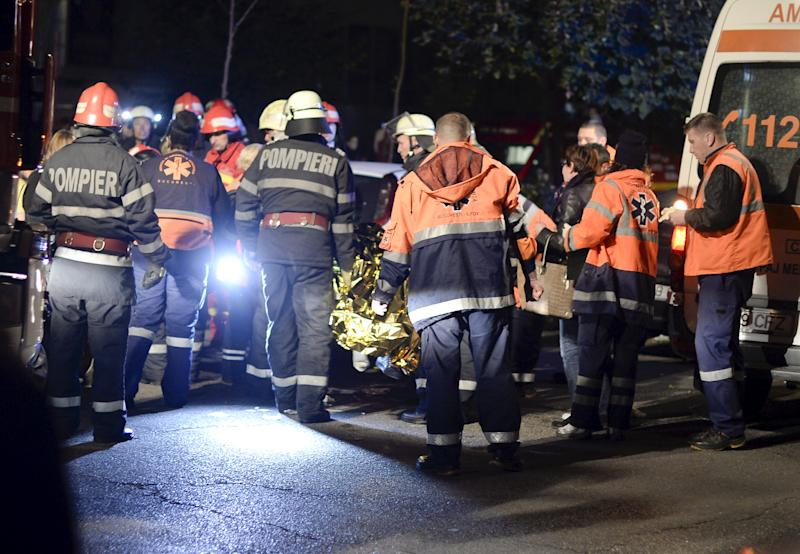 Emergency services work outside a nightclub in Bucharest, Romania October 31, 2015. Twenty five died in a nightclub blast and fire late on Friday and at least 88 people were admitted to hospital, government officials said. REUTERS/Inquam Photos THIS IMAGE HAS BEEN SUPPLIED BY A THIRD PARTY. IT IS DISTRIBUTED, EXACTLY AS RECEIVED BY REUTERS, AS A SERVICE TO CLIENTS. ROMANIA OUT. NO COMMERCIAL OR EDITORIAL SALES IN ROMANIA.      TPX IMAGES OF THE DAY