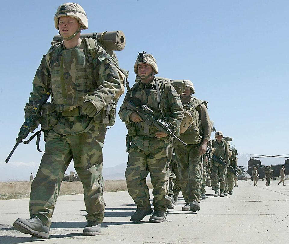 In this file photo taken on March 12, 2002, US soldiers arrive at Bagram Air Base, in Bagram.  All US and NATO troops have left Bagram Air Base, a US defence official told AFP Friday, signaling the complete withdrawal of foreign forces from Afghanistan was imminent.