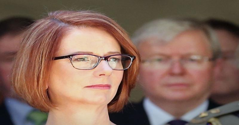 Prime Minister of Australia Julia Gillard with former Prime Minister Kevin Rudd in the background.