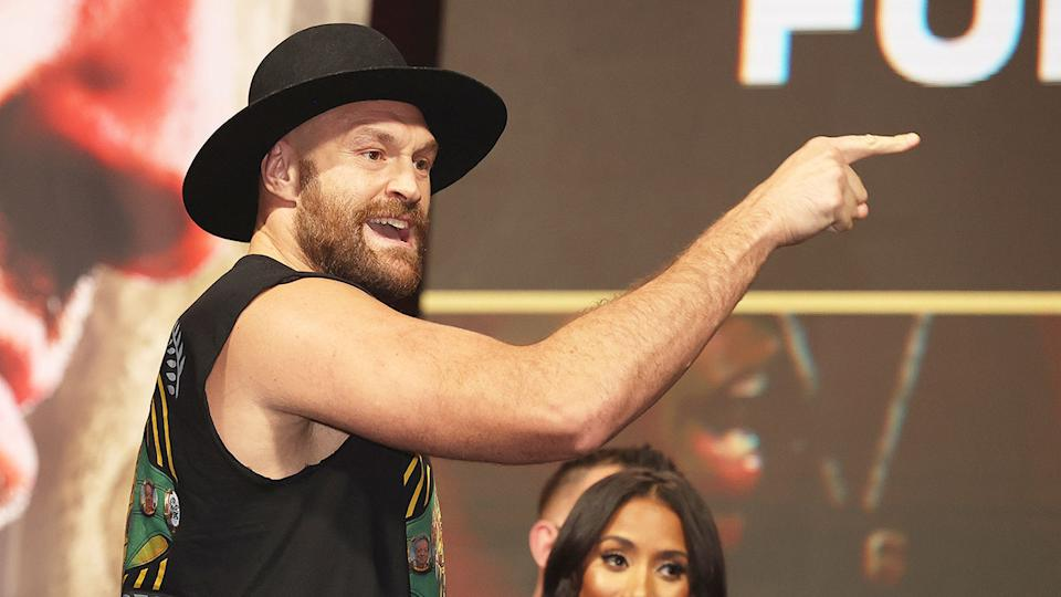 Seen here, Tyson Fury taunts Deontay Wilder during a pre-fight war of words.