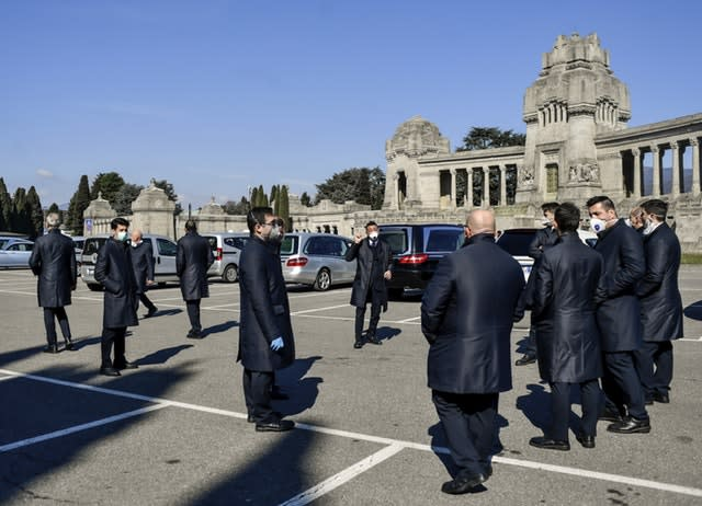 Pallbearers outside a cemetery in Bergamo