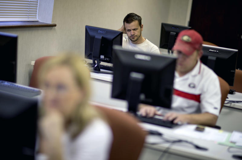 US hiring outlook improves as jobless claims drop