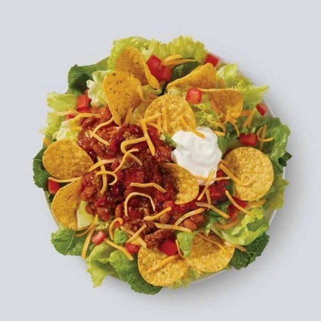 """<p><strong>What is it:</strong> Made fresh daily with Wendy's signature lettuce blend, shredded cheddar cheese, diced tomatoes, salsa, sour cream, tortilla chips, and Wendy's famous, hearty chilli. A fresh take on tacos perfect for Tuesdays, Wednesdays, or any other days for that matter.</p><p><strong>Why it's top tier: </strong>Let's be honest: this is more 'loaded nachos' than it is a salad.</p><p><a href=""""https://www.instagram.com/p/B01bmgAjHrG/"""" rel=""""nofollow noopener"""" target=""""_blank"""" data-ylk=""""slk:See the original post on Instagram"""" class=""""link rapid-noclick-resp"""">See the original post on Instagram</a></p>"""