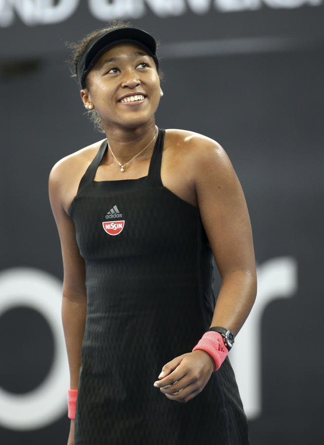 Naomi Osaka of Japan reacts after winning a point during her quarterfinal match against Anastasija Sevastova of Latvia at the Brisbane International tennis tournament in Brisbane, Australia, Thursday, Jan. 3, 2019. (AP Photo/Tertius Pickard)