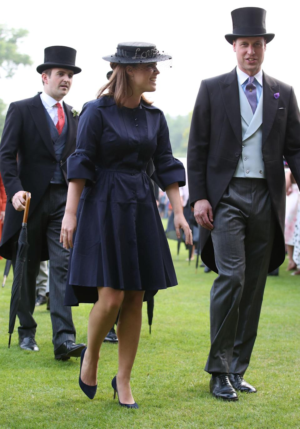 Now that you've found her, take a moment to appreciate Princess Beatrice and Prince William adhering to the formal dress code, with Wills wearing in a morning dress. [Photo: Getty]