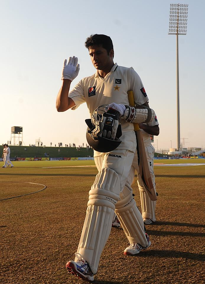 Pakistan's Azhar Ali leaves the ground at the end of the third day of the second Test match between Pakistan and England at Sheikh Zayed Stadium in Abu Dhabi on January 27, 2012.      AFP PHOTO/LAKRUWAN WANNIARACHCHI (Photo credit should read LAKRUWAN WANNIARACHCHI/AFP/Getty Images)
