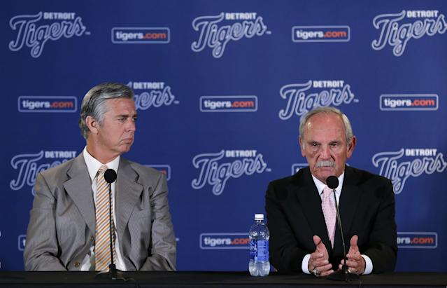 Detroit Tigers baseball manager Jim Leyland, right, announces his retirement as general manager David Dombrowski, left, listens during a news conference at Comerica Park in Detroit, Monday, Oct. 21, 2013. (AP Photo/Paul Sancya)