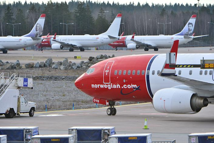 Parked Boeing 737-800 aircrafts belonging to budget carrier Norwegian seen at at Stockholm Arlanda Airport Thursday March 5, 2015. 650 pilots employed by Norwegian Air Norway (NAN) are on strike grounding flights in Norway, Sweden and Denmark.  (AP Photo/Johan Nilsson / TT)  SWEDEN OUT