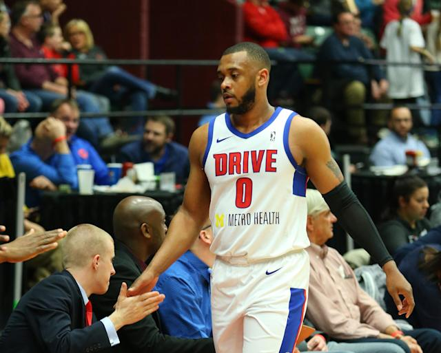Zeke Upshaw of the Grand Rapids Drive high-fives coaches and teammates during a game on March 23, 2018. Upshaw collapsed on the court late in Saturday's game against the Long Island Nets. He died in the hospital on Monday morning. He was 26. (Getty)