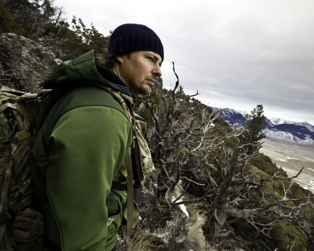Park County, MT, USA: Casey Anderon exploring a prime mountain lion habitat.