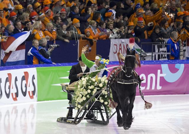 FILE - In this Jan. 13, 2013, file photo, new European champion Sven Kramer, of the Netherlands, rides a lap of honor in a horse-pulled sled after winning the allround European speedskating championship at Thialf stadium in Heerenveen, northern Netherlands. Time and again over the last half century, the Dutch are top or near the top of the speedskating standings at any Olympic and for a nation of 16.8 million, it often defies giants like the United States, Russia or Germany. This time too, the Dutch have a realistic chance for a half dozen gold medals on the big oval. (AP Photo/Peter Dejong, File)