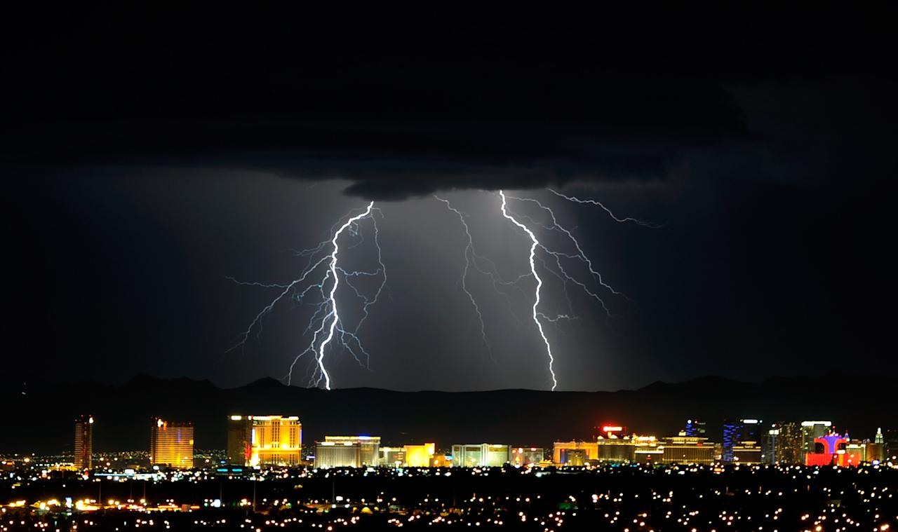 LAS VEGAS, NV - SEPTEMBER 13:  Lightning flashes east of the Las Vegas Strip during a thunderstorm early on September 13, 2011 in Las Vegas, Nevada. Stormy weather is expected to continue through Thursday.  (Photo by Ethan Miller/Getty Images)