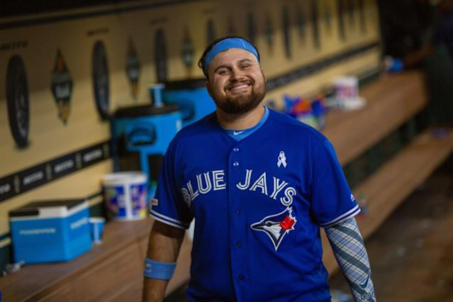 Rowdy Tellez smiles in the dugout after an MLB baseball game between the Houston Astros and the Toronto Blue Jays. (Photo by Juan DeLeon/Icon Sportswire via Getty Images)