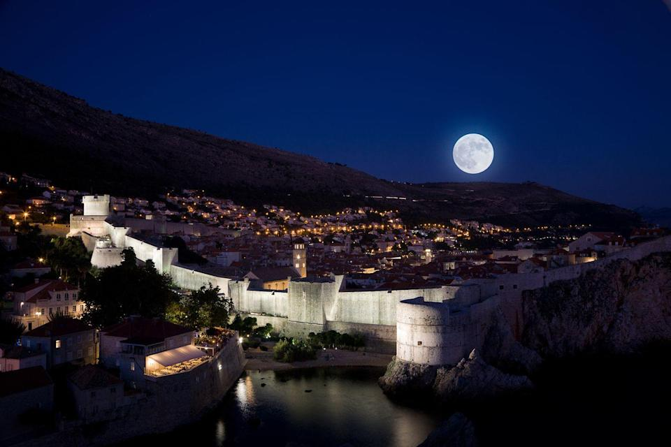 """<p>There is something magnetic about cities that come alive at night and Dubrovnik, while not an obvious first suggestion, is one of those. Gorgeous during the day as well, this hotspot, made unforgettable by its appearances on <em>Game of Thrones</em>, also boasts killer views.</p><p>When the sun dips down behind the Adriatic Sea and the moon shines above, the city unveils a whole new side of its personality. The moon reflecting off the calm waters of the Old Port give the harbor walls an iridescent glow, and despite the panoramic views the city offers during the day, this is the most beautiful time of a day spent in Dubrovnik. After a late night of midnight marveling, the best place to rest your head is <a rel=""""nofollow noopener"""" href=""""http://www.villa-dubrovnik.hr/"""" target=""""_blank"""" data-ylk=""""slk:Villa Dubrovnik"""" class=""""link rapid-noclick-resp"""">Villa Dubrovnik</a>. Overlooking the turquoise waters and nestled amongst orange and lemon groves, this boutique hotel is the most peaceful place to wake up after a night on the town–and their many terraces allow you to take in the old city's stunning views.</p>"""