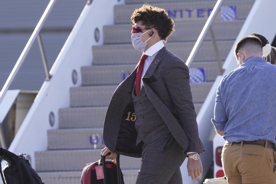 Kansas City Chiefs quarterback Patrick Mahomes arrives with his teammates for the NFL Super Bowl 55 football game against the Tampa Bay Buccaneers, Saturday, Feb. 6, 2021, in Tampa, Fla. (AP Photo/Charlie Riedel)