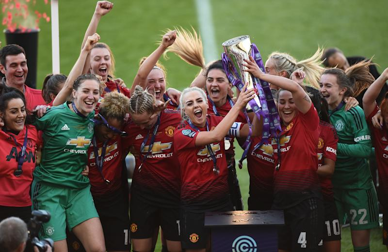 LEIGH, GREATER MANCHESTER - MAY 11: Manchester United players celebrate after they win Women's Super League 2 trophy after the match between Manchester United Women and Lewes Women at Leigh Sports Village on May 11, 2019 in Leigh, Greater Manchester. (Photo by Nathan Stirk/Getty Images)