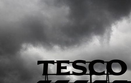 FILE PHOTO: Grey clouds hang over a Tesco Extra store in New Malden, London
