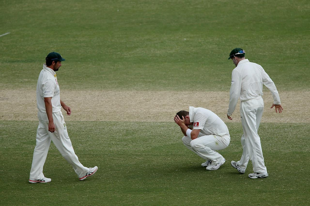 ADELAIDE, AUSTRALIA - NOVEMBER 26: Peter Siddle reacts after the last over of play during day five of the Second Test Match between Australia and South Africa at Adelaide Oval on November 26, 2012 in Adelaide, Australia.  (Photo by Morne de Klerk/Getty Images)