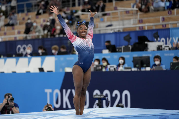 Simone Biles, of the United States, finishes on the balance beam during the artistic gymnastics women's apparatus final at the 2020 Summer Olympics, Tuesday, Aug. 3, 2021, in Tokyo, Japan. (AP Photo/Ashley Landis)