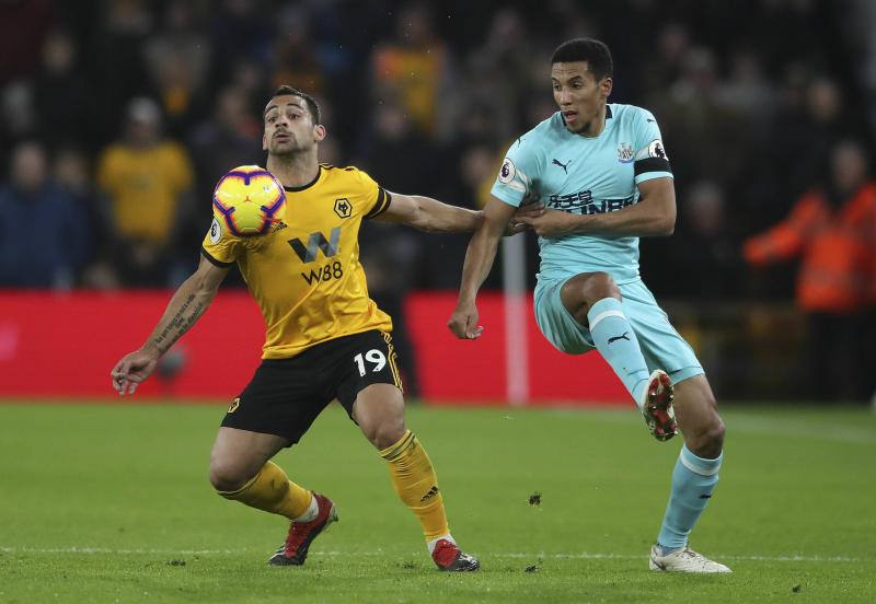 Wolverhampton Wanderers' Jonny Castro, left and Newcastle United's Isaac Hayden battle for the ball, during the English Premier League soccer match between Wolverhampton Wanderers and Newcastle United, at Molineux, in Wolverhampton, England, Monday, Feb. 11, 2019. (Nick Potts/PA via AP)