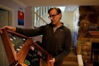 Mark Giaconia, who served for 20 years in the U.S. Army, of which 15 years in the U.S. Special Forces and was embedded with the Kurds in Iraq, shows his medals at his house in Herndon