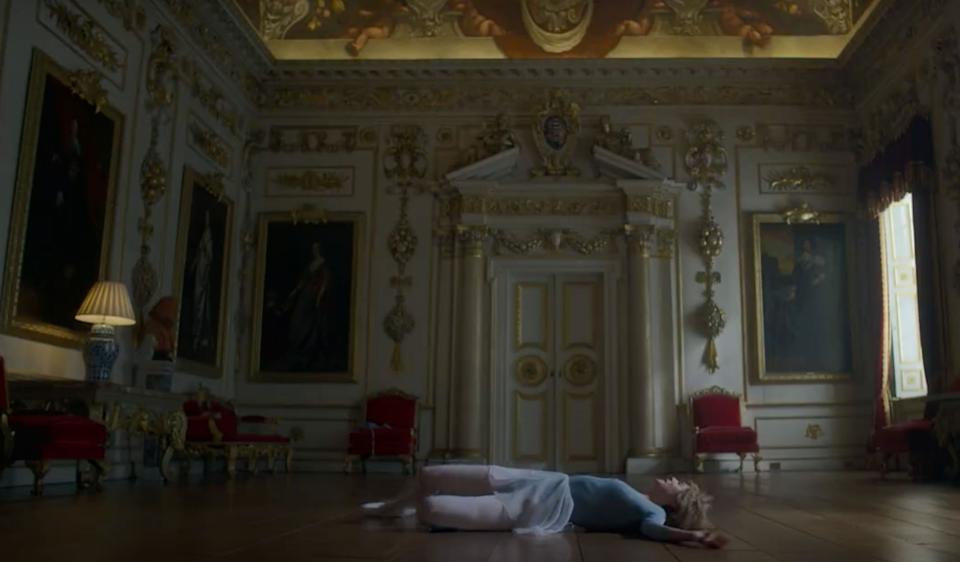 Princess Diana falls to the floor after wildly dancing in a new trailer for The Crown (Photo: Netflix)