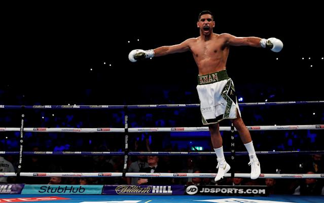 Boxing - Amir Khan v Phil Lo Greco - Echo Arena, Liverpool, Britain - April 21, 2018 Amir Khan celebrates after winning the fight Action Images via Reuters/Andrew Couldridge TPX IMAGES OF THE DAY