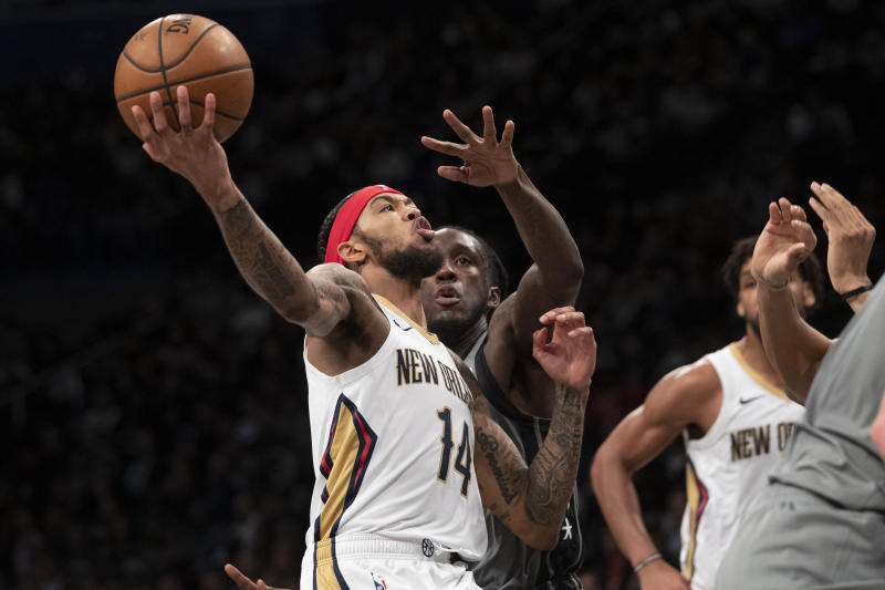 New Orleans Pelicans forward Brandon Ingram (14) goes to the basket against Brooklyn Nets forward Taurean Prince during the first half of an NBA basketball game, Monday, Nov. 4, 2019, in New York. (AP Photo/Mary Altaffer)