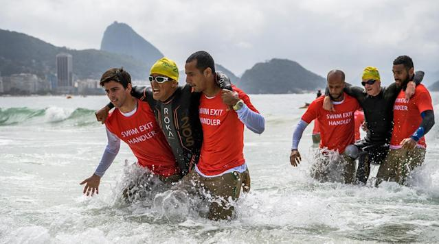 <p>Mohamed Lahna of Morocco (left) and Stephane Bahier of France are aided out of the water during the Men's PT2 Triathlon competition at Fort Copacabana at the Paralympic Games in Rio de Janeiro, Brazil.</p>
