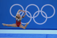 Angelina Melnikova, of the Russian Olympic Committee, performs her floor exercise during the women's artistic gymnastic qualifications at the 2020 Summer Olympics, Sunday, July 25, 2021, in Tokyo. (AP Photo/Gregory Bull)