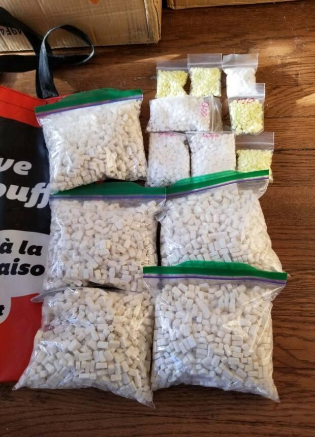 Police in P.E.I. seized thousands of methamphetamine tablets and hydromorphone pills at a property in Mermaid on March 5, 2021.  (Submitted by Stratford RCMP - image credit)