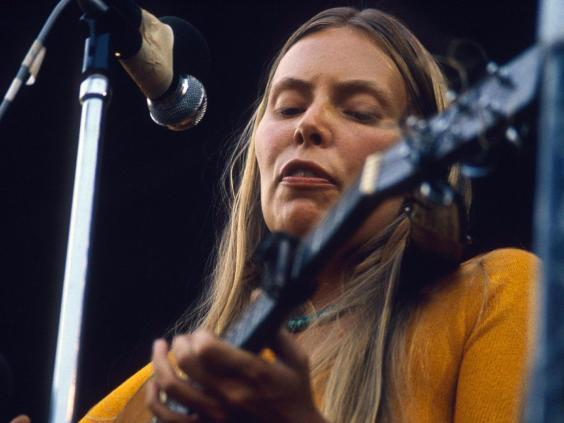 Bongo interruption: Joni Mitchell performing at the Isle of Wight Festival in 1970 (Rex)
