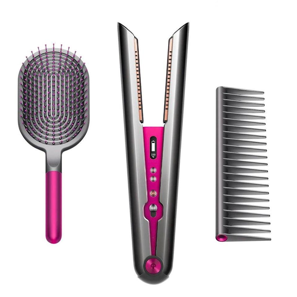 """You might not be ready to spend major dough on a fancy flatiron, either, but we've reviewed this high-tech styling tool <a href=""""https://www.glamour.com/story/dyson-corrale-hair-straightener-review?mbid=synd_yahoo_rss"""" rel=""""nofollow noopener"""" target=""""_blank"""" data-ylk=""""slk:here"""" class=""""link rapid-noclick-resp"""">here</a> and <a href=""""https://www.glamour.com/story/dyson-corrale-hair-straightener-review?mbid=synd_yahoo_rss"""" rel=""""nofollow noopener"""" target=""""_blank"""" data-ylk=""""slk:here"""" class=""""link rapid-noclick-resp"""">here</a> to outline why it may be worth incorporating into your everyday beauty routine (mainly due to its ability to decrease unwanted heat damage). And for a limited time at Sephora, you can get the Dyson bundle that includes a complimentary paddle brush and detangling comb for a professional-level final product. $565, Sephora. <a href=""""https://www.sephora.com/product/dyson-corrale-hair-straightener-holiday-set-P461445"""" rel=""""nofollow noopener"""" target=""""_blank"""" data-ylk=""""slk:Get it now!"""" class=""""link rapid-noclick-resp"""">Get it now!</a>"""
