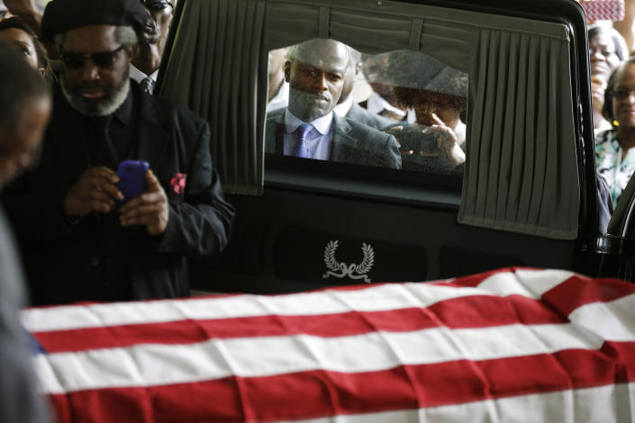 Mourners look on as the casket of Walter Scott is removed from a hearse for his funeral at W.O.R.D. Ministries Christian Center, Saturday, April 11, 2015, in Summerville, S.C. Scott was killed by a North Charleston police officer after a traffic Saturday, April 4, 2015. (David Goldman/Getty Images)