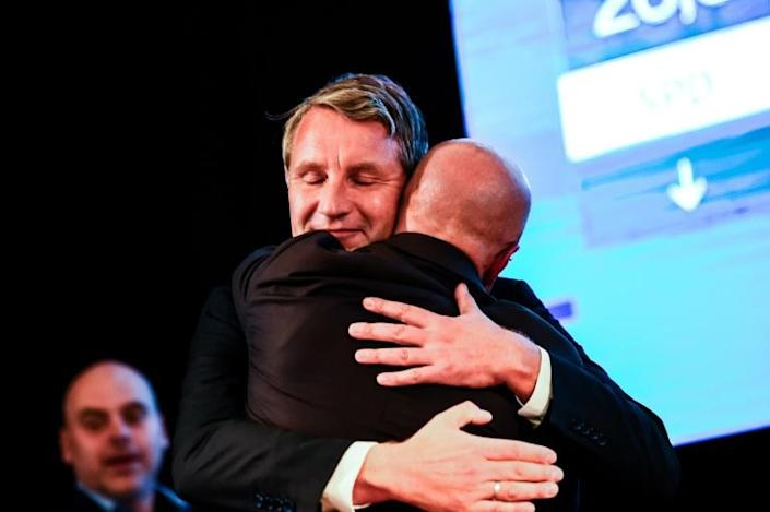 Andreas Kalbitz (right), top AfD candidate of the far-right AfD in Brandenburg state, is congratulated by Bjoern Hoecke, party co-leader and candidate for upcoming elections in fellow eastern state Thuringia (AFP Photo/Gregor Fischer)