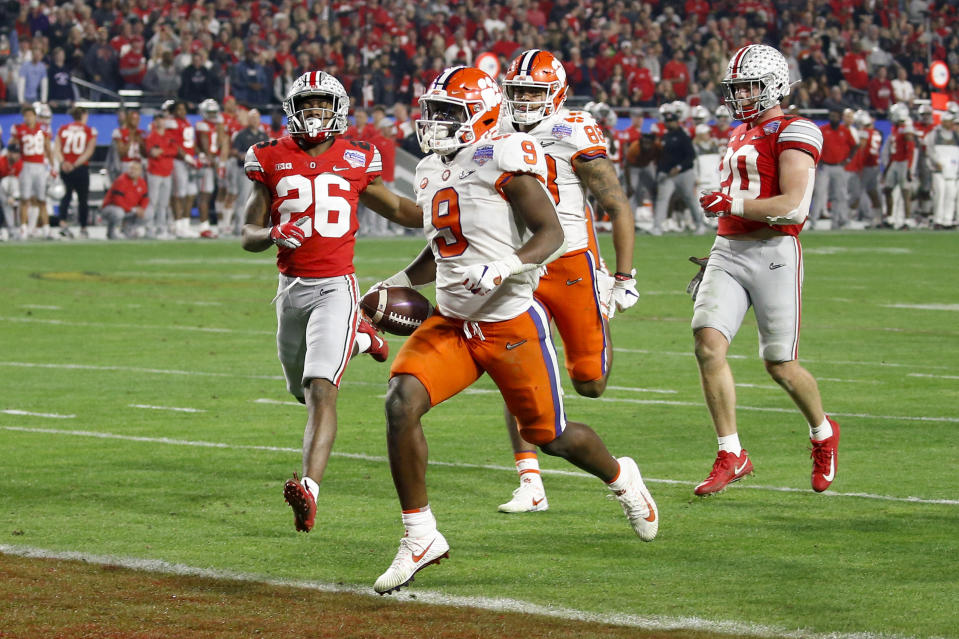 Clemson running back Travis Etienne scores a touchdown against Ohio State during the second half of the Fiesta Bowl NCAA college football playoff semifinal Saturday, Dec. 28, 2019, in Glendale, Ariz. (AP Photo/Ross D. Franklin)