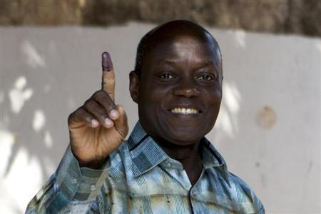 Presidential candidate Jose Mario Vaz shows his inked finger after voting in Bissau