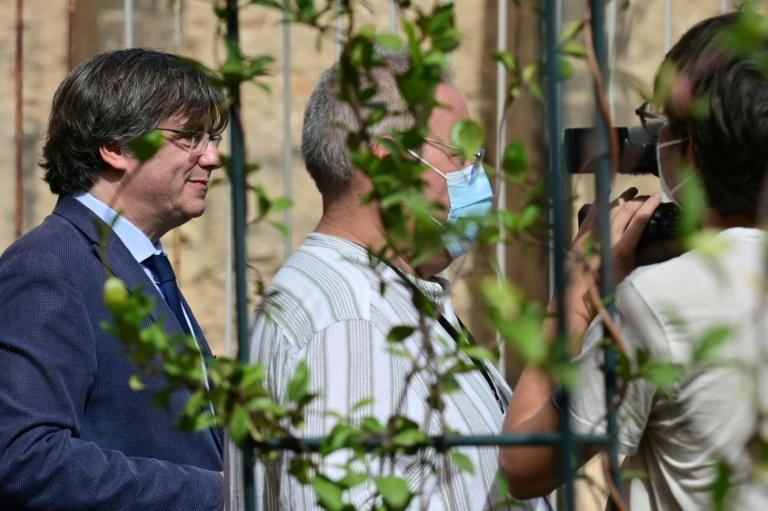 Puigdemont, 58, said he would return to court in Sardinia on October 4 after first attending a foreign trade committee in Brussels (AFP/MIGUEL MEDINA)