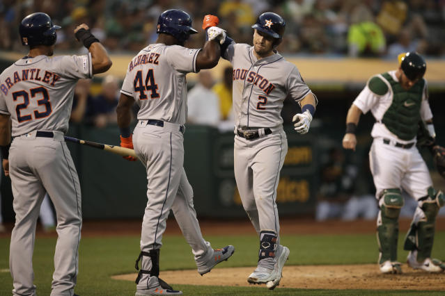 Houston Astros' Alex Bregman (2) celebrates with Michael Brantley, left, and Yordan Alvarez (44) after hitting a two-run home run off Oakland Athletics' Mike Fiers during the fourth inning of a baseball game Thursday, Aug. 15, 2019, in Oakland, Calif. (AP Photo/Ben Margot)