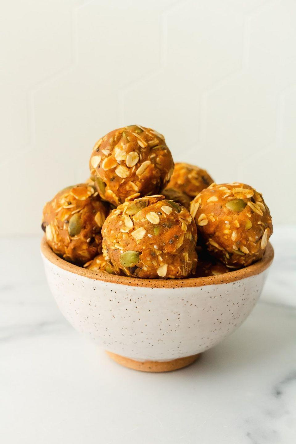 """<p>Michalczyk makes these protein balls whenever she's craving something sweet but wants to keep it healthy and filling, too. </p><p><a class=""""link rapid-noclick-resp"""" href=""""https://www.onceuponapumpkinrd.com/pumpkin-cookie-protein-balls/"""" rel=""""nofollow noopener"""" target=""""_blank"""" data-ylk=""""slk:GET THE RECIPE"""">GET THE RECIPE</a></p><p><em>Per serving: 152 calories, 8 g fat, 14 g carbs, 224 mg sodium, 5 g sugar, 10 g fiber, 7 g protein</em></p>"""
