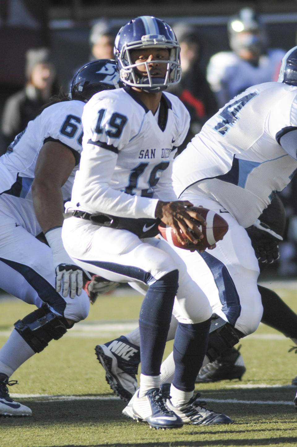 San Diego quarterback Keith Williams (19) turns to hand off the ball during the first half of an NCAA college football playoff game against Montana, Saturday, Nov. 29, 2014, in Missoula, Mont. (AP Photo/Lido Vizzutti)