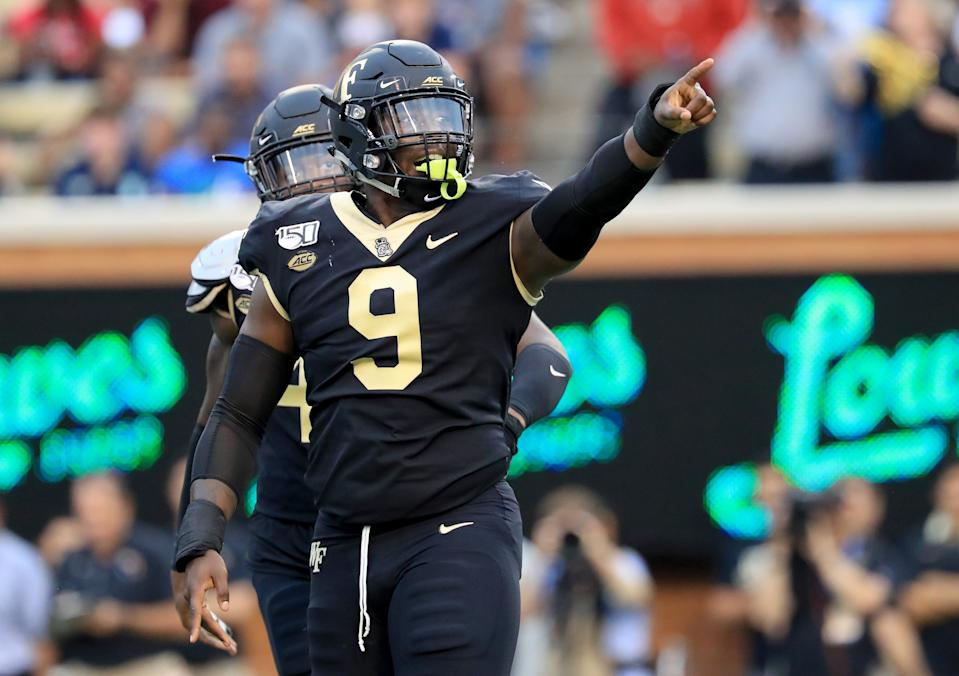 WINSTON SALEM, NORTH CAROLINA - SEPTEMBER 13: Carlos Basham Jr. #9 of the Wake Forest Demon Deacons reacts after a defensive play against the North Carolina Tar Heels during their game at BB&T Field on September 13, 2019 in Winston Salem, North Carolina. (Photo by Streeter Lecka/Getty Images)