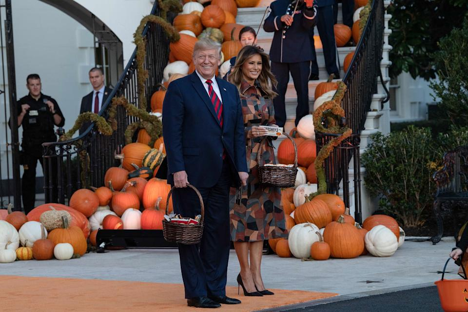 President Donald Trump and First Lady Melania Trump arrive to hand out candy for children at a Halloween celebration at the White House in Washington, D.C. (Photo: Nicholas Kamm via Getty Images)