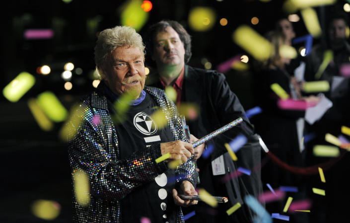 """CORRECTS AGE TO 88 - FILE - In this Wednesday, Oct. 13, 2010, file photo, comedian Rip Taylor throws confetti on photographers at the premiere of the film """"Jackass 3D,"""" in Los Angeles. Taylor, the mustached comedian with a fondness for confetti-throwing who became a television game show mainstay in the 1970s, died Sunday, Oct. 6, 2019. He was 88. (AP Photo/Chris Pizzello, File)"""