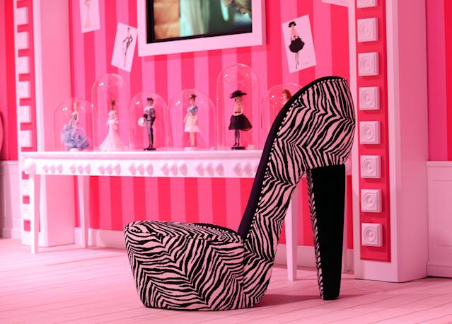 A chair in the shape of a high-heel is is displayed in the Barbie Dreamhouse Experience near Alexanderplatz square in Berlin, Germany,Thursday May 16, 2013. The 2,500 square meter Barbie Dreamhouse Experience will be open for three months in Berlin. (AP Photo/dpa, Jens Kalaene)